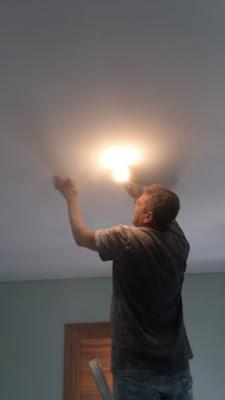Lixamento de teto com lâmpada SP