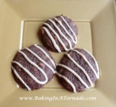 Chocolate PB Chip Cookies with Peanut Butter Drizzle | www.BakingInATornado.com | #recipe