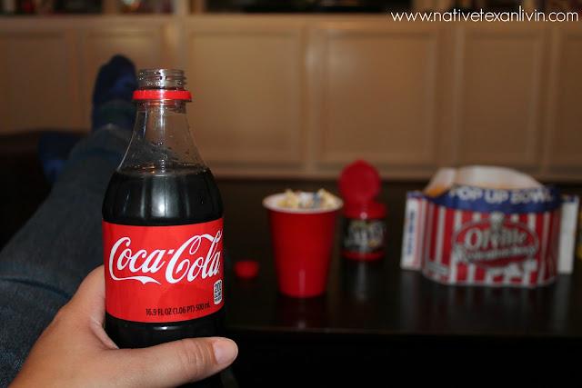 Ice cold Coca-Cola & White Chocolate Trash Mix made with Orville Redenbacher popcorn, M&M'S®, pretzels & white bark