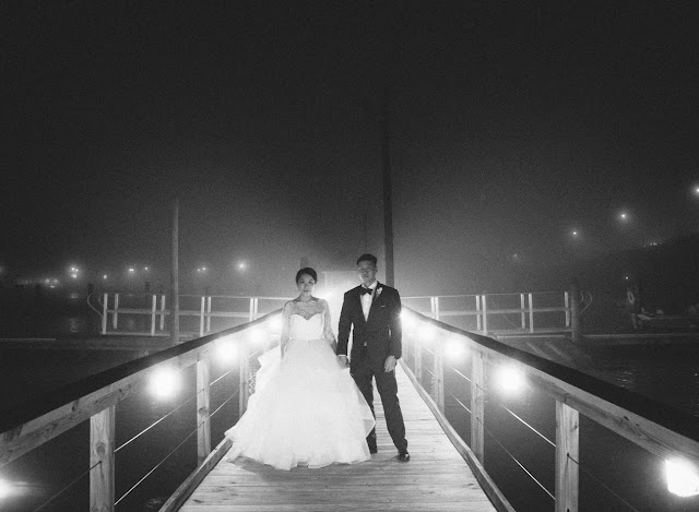 Jin and Christopher at night on the dock after their Bridgeview Yacht Club wedding