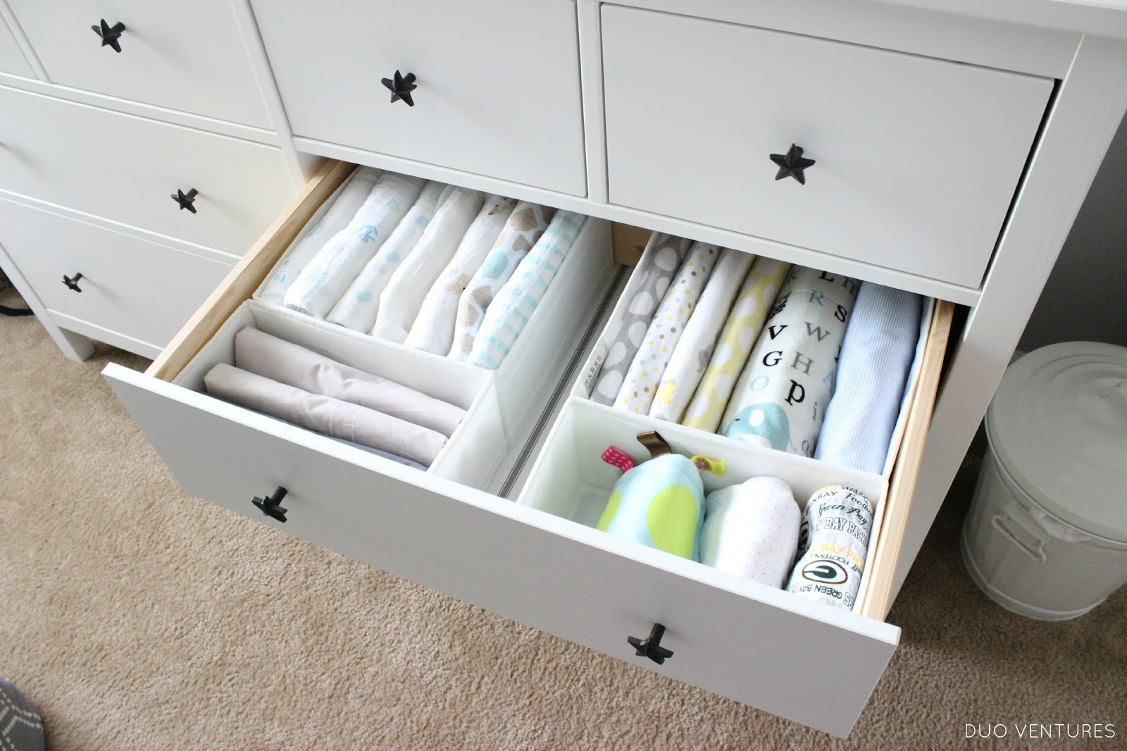 Ikea Mandal Dresser Nursery ~   also purchased a couple sets of the SKUBB drawer organizers from IKEA