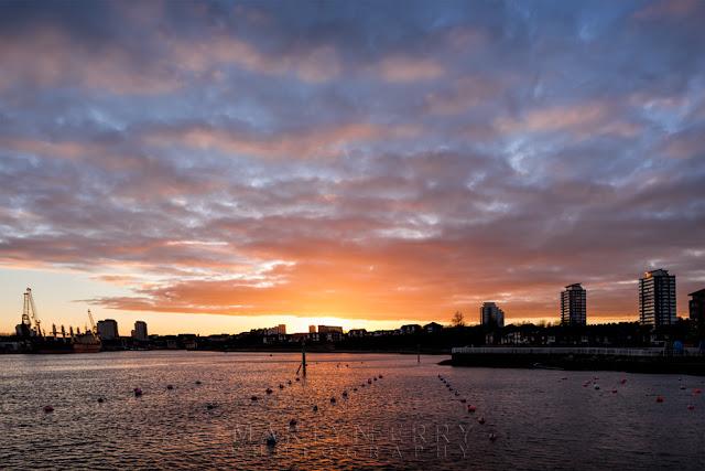 Sunderland harbour at sunset under orange clouds