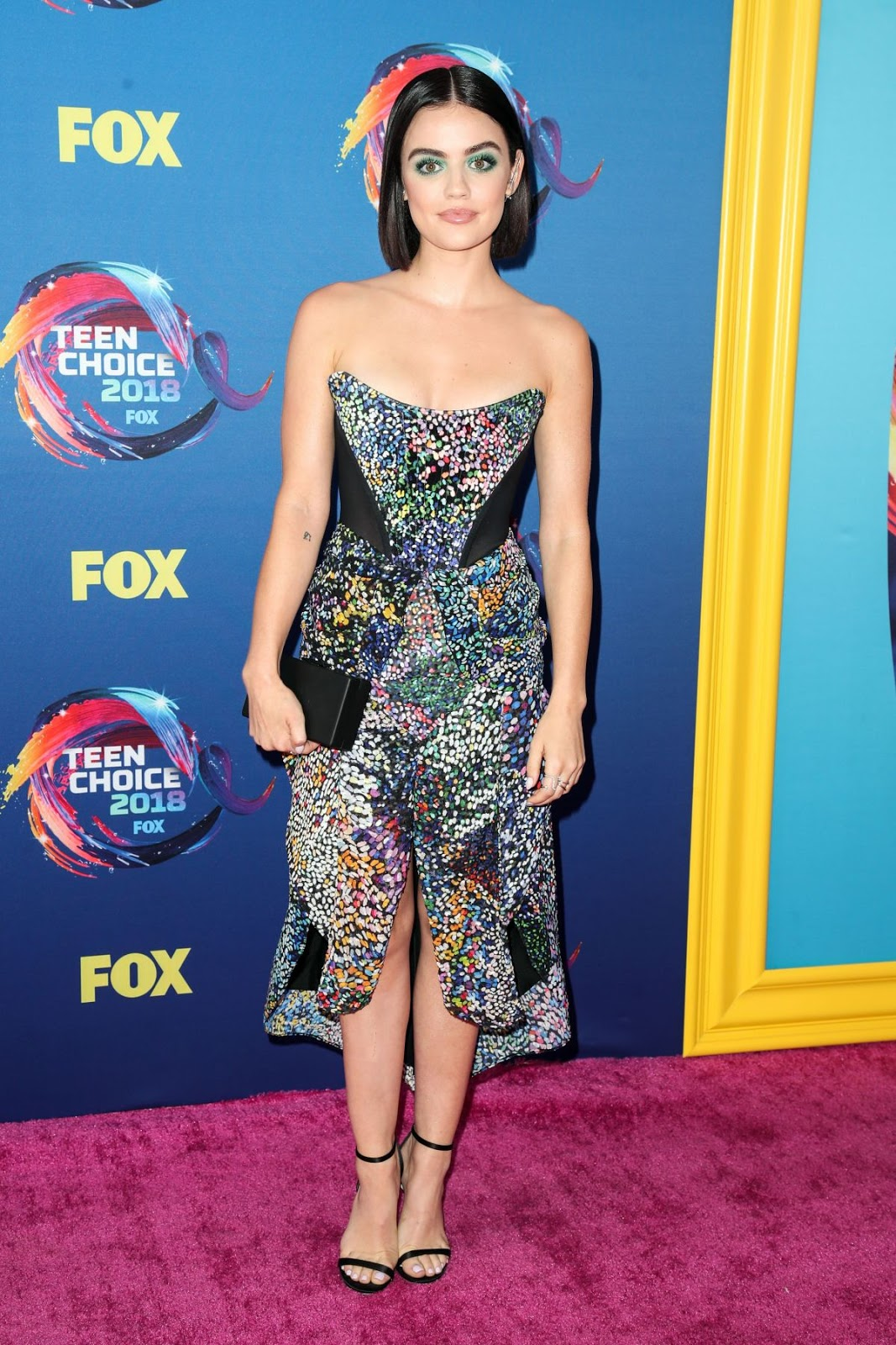 Lucy Hale stuns in splashy green eye make-up as she walks the Teen Choice Awards red carpet