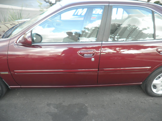 2000 Nissan Altima after collision repairs at Almost Everything Auto Body