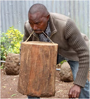 Believe it or not this Kenyan man can lift a 30kg log with his teeth - See PHOTOs