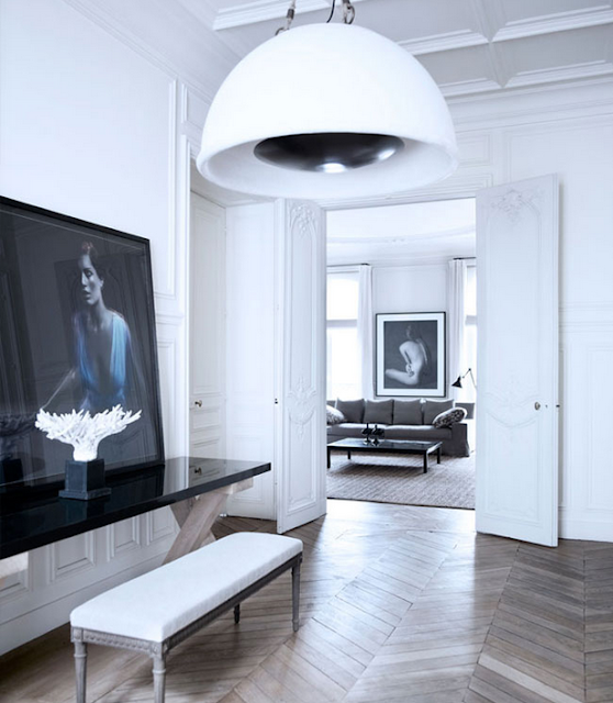 Gilles & Boissier design entry way with chevron floor and white walls