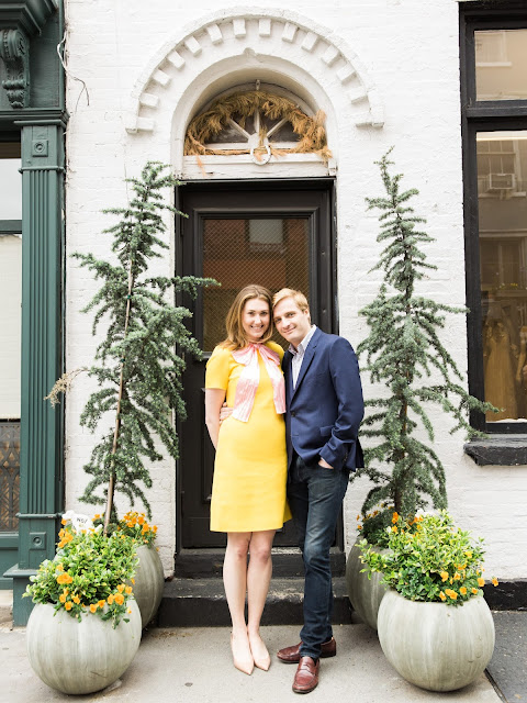 Liz and Ted smile near a quirky shop doorway Greenwich Village Engagement Portraits