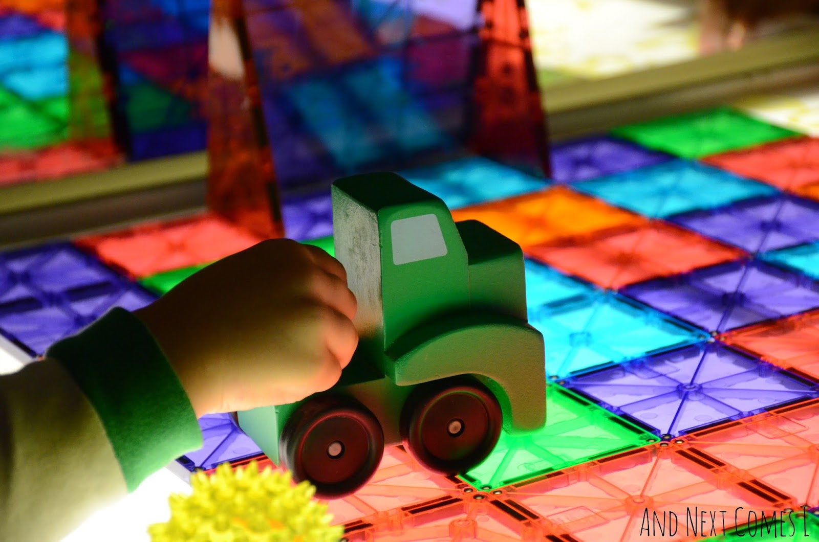 Truck driving on a soccer field made of Magna-Tiles from And Next Comes L