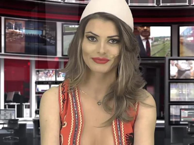 Presenter Greta Hoxhaj, 24 poses prior her news edition on