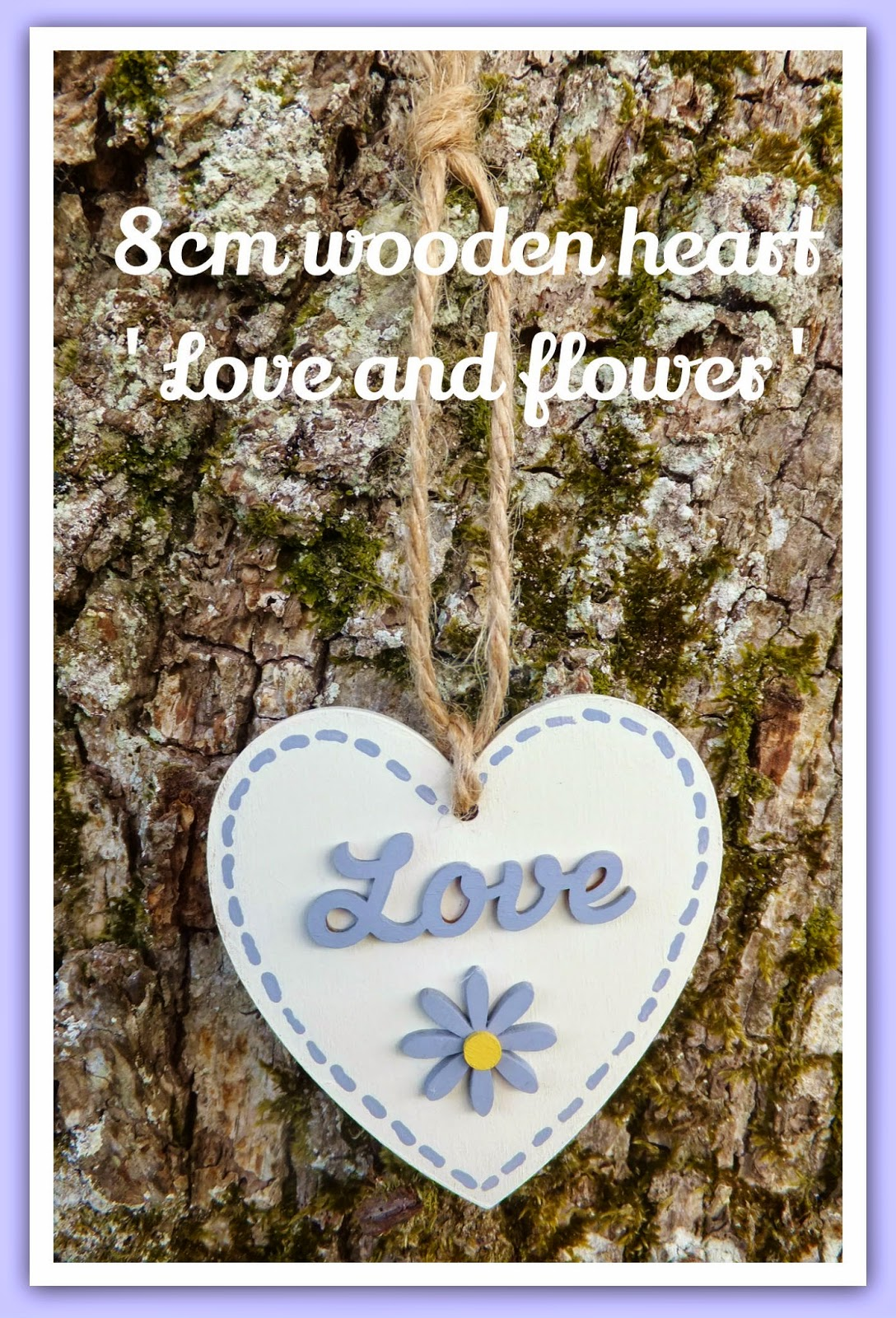 painted wooden heart decoration hanging on tree