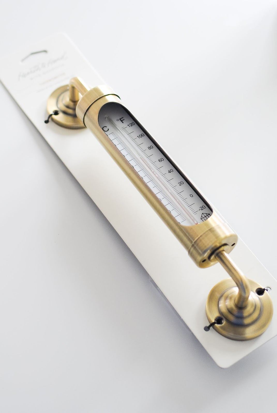 Gorgeous brass thermometer adds a glam decor touch to any space.