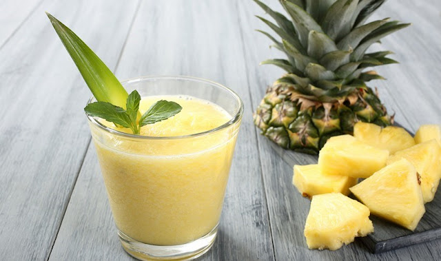 Healthy tropical pineapple, orange and banana smoothie