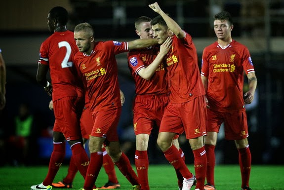 Adam Morgan of Liverpool U-21 celebrates scoring his side's first goal against Manchester City U-21