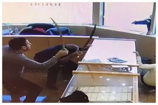 Swordmen fight off armed robbers