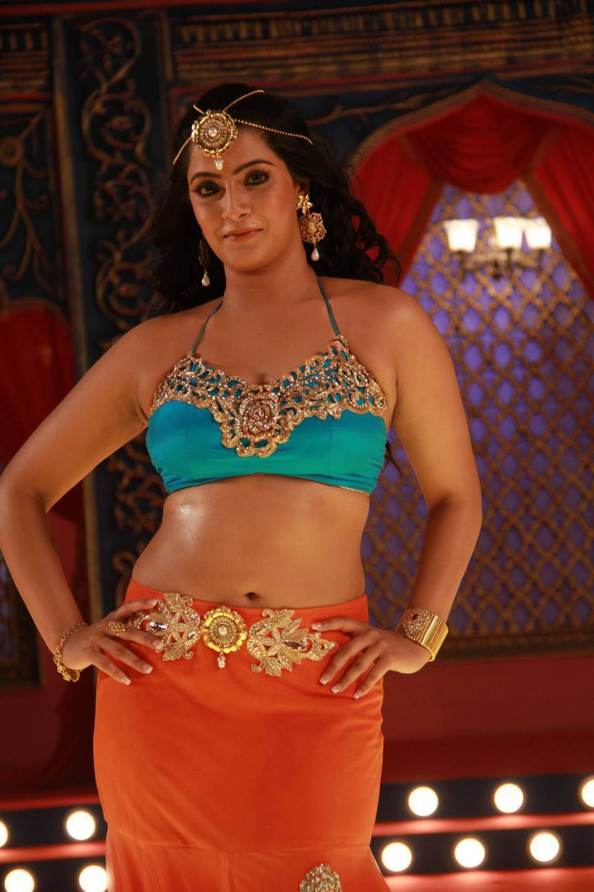 Varalaxmi Sarathkumar Navel Hip Show Photos From Tamil Movie In Orange Saree