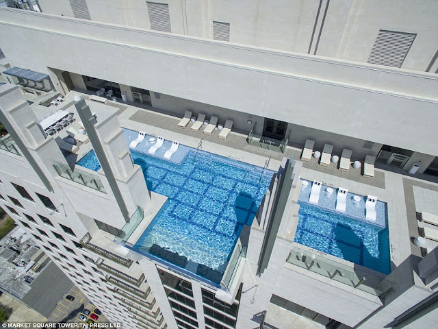 Glass bottomed swimming pool on 42nd floor jets out into thin air