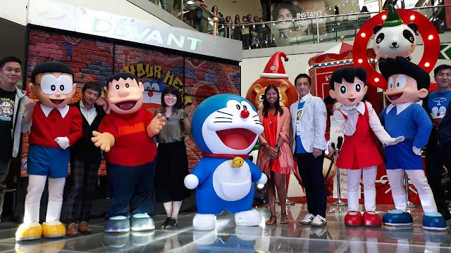 Complete main characters of Doraemon, Nobita, Shizuka, Damulag (Gian/Takeshi) and Suneo, with Takamitsu Kayahara, Director, Doraemon Business Division, ShoPro; Aki Gotanda, International Licensing, Doraemon Business Division, ShoPro; Tim Kondo, General Manager, Animation International, Ltd...