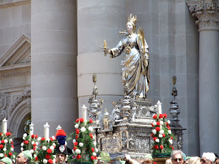 A silver statue of Santa Lucia is borne through the  streets of Syracuse on December 13 each year