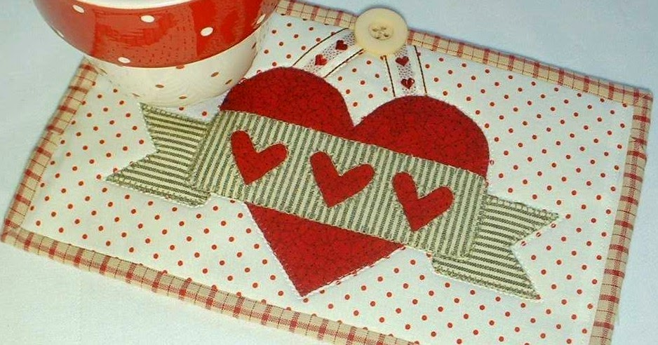 http://www.craftsy.com/pattern/quilting/home-decor/valentine-banner-mug-rug/84359
