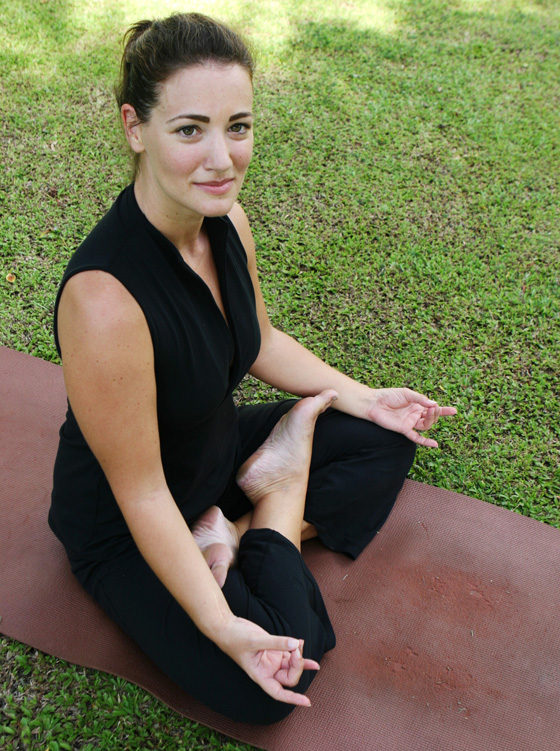 Beautiful woman practising yoga in the park.