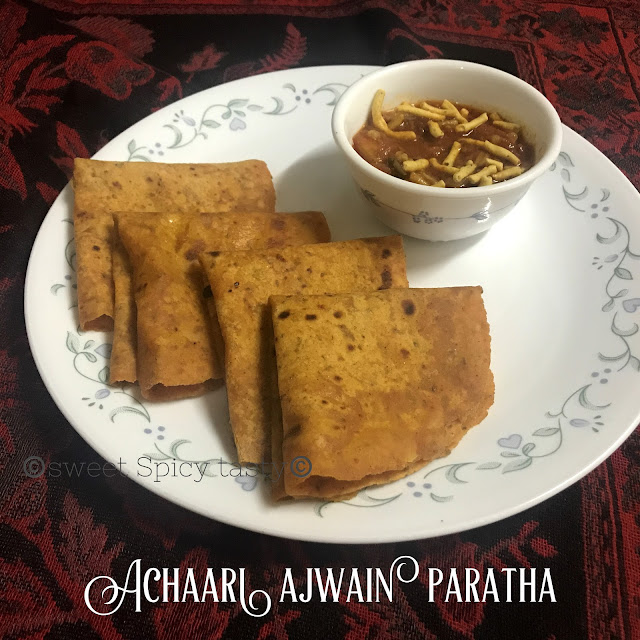 achaari ajwain paratha, paratha , indian flat bread, pickled flat bread , pickle flavored flat bread, achari paratha, ajwain parantha, achari parantha, picnic meal, lunch box , jain parantha, jain paratha, no onion no garlic paratha