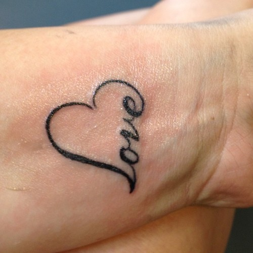 See more Heart and love tattoo on wrist