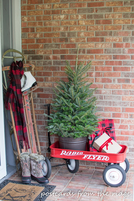 Radio Flyer wagon on a front porch at Christmas. Love it!!