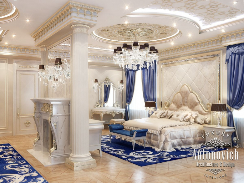 Interior design consultant gracefully repeats curls of carved headboard in the stucco on the ceiling here everything adjusts to cozy serenity