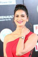 Meenakshi Dixit in Red One Shoulder Red Zipped up gown at IIFA Utsavam Awards009.JPG