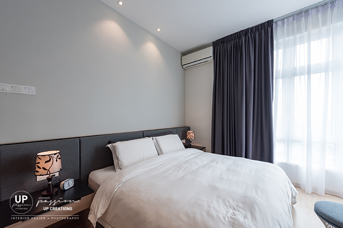 royal regent condo master bedroom with dark grey color cushion bedhead and light grey color wall
