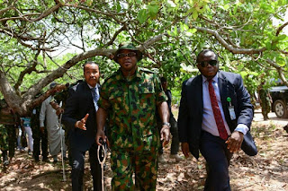 GOVERNOR BELLO ROCKS MILITARY CAMOUFLAGE WHILE EATING 'EBA' WITH SOLDIERS