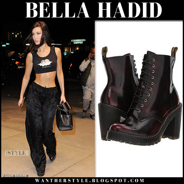 Bella Hadid in black fiorucci crop top, track pants and platform lace-up boots dr. martens kendra model off duty style november 8