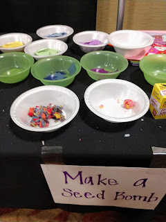 colorful bits of wet construction paper in bowls for kids to make seed bombs at the 2019 Siouxland Garden Show