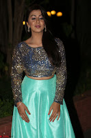 Nikki Galrani in Green Skirt  Top at Marakathamani music launch ~  Exclusive (23).JPG