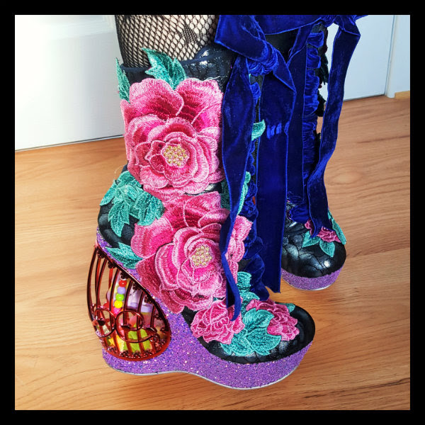 close up floral applique uppers on Irregular Choice Maya birdcage boots