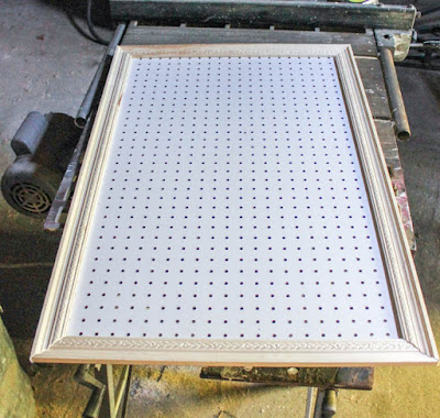 pegboard frame made with decorative moulding