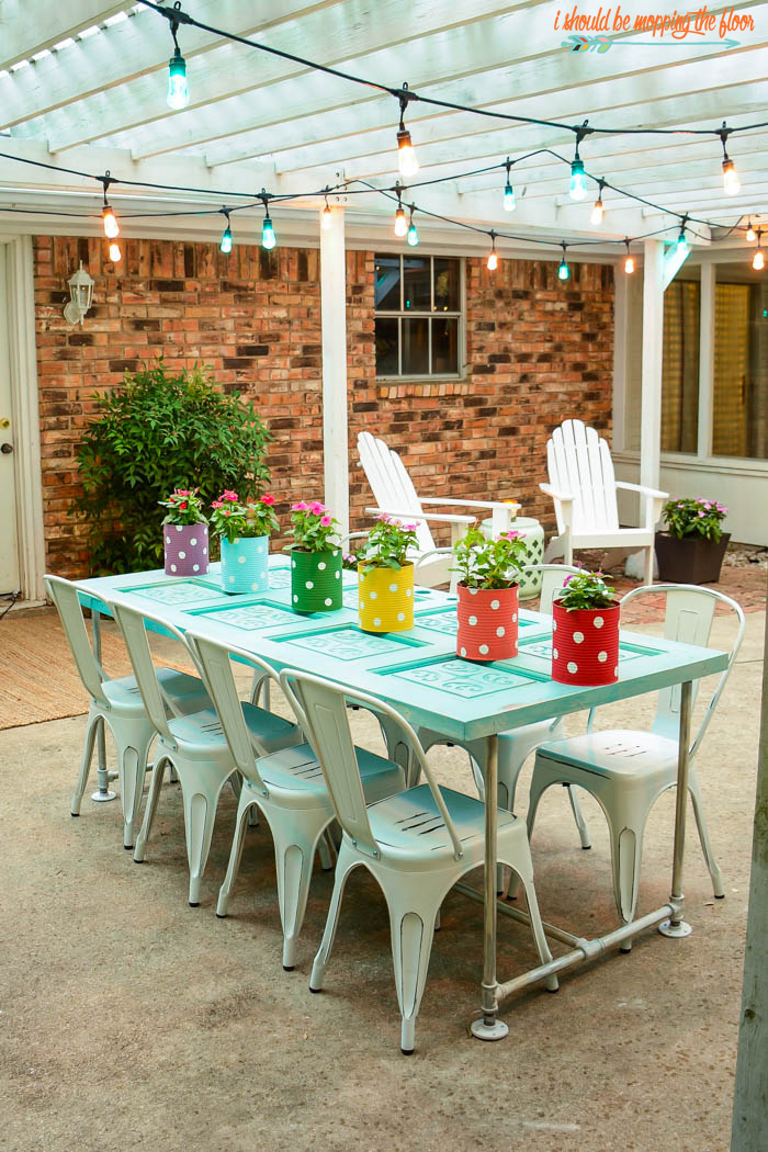 Colorful Patio Makeover | Lots of fun, whimsical, homemade touches, and colorful lights make this patio a great spot to hang out!