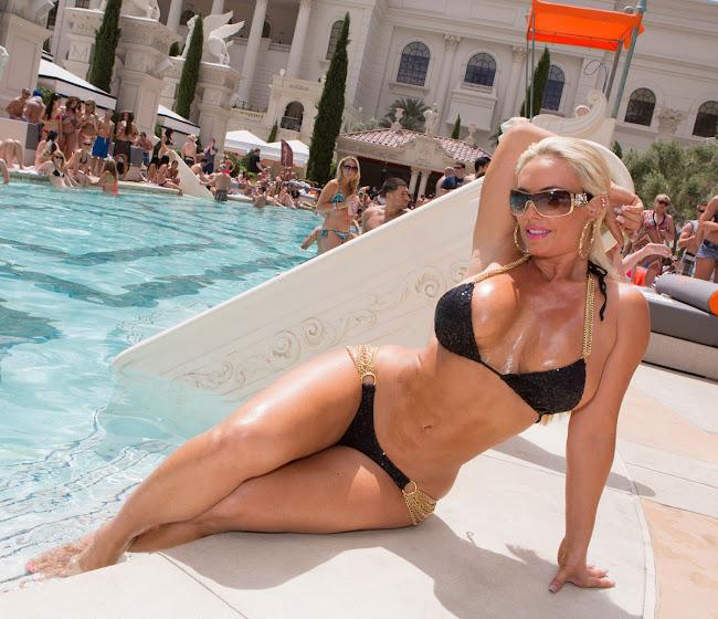 Nicole Coco Austin shows off her body in a small black bikini