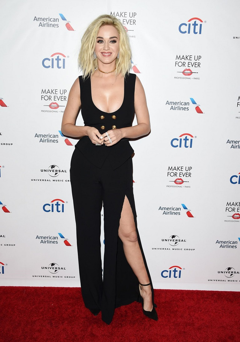 Katy Perry flaunts her ample cleavage in plunging split-leg jumpsuit for Universal Grammy after-party