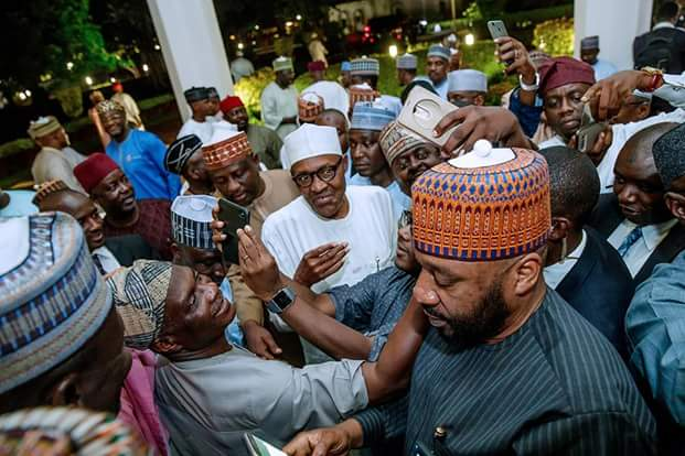"Photos of President Buhari with his ""loyalists"" at the House of Representatives a week before the defection Tsunami"
