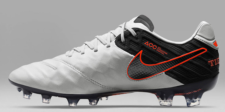 fd484acdf7d The launch colorway of the Nike Tiempo Legend VI Cleats combines the  classic colors white and black with striking orange details to add a fresh  touch for ...