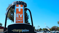 A parking lot in Rosemead, California, with two electric vehicle charging stations. (Photo Credit: Frederic J. Brown/AFP via Getty Images) Click to Enlarge.