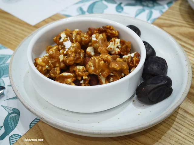 Buka puasa with their home made popcorn and dates