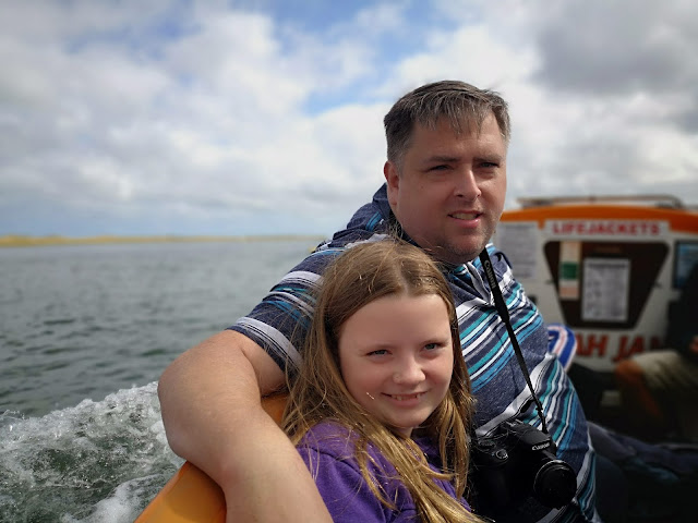 Father and daughter on a boat