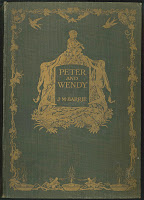 "A gold-stamped cover for ""Peter and Wendy."""