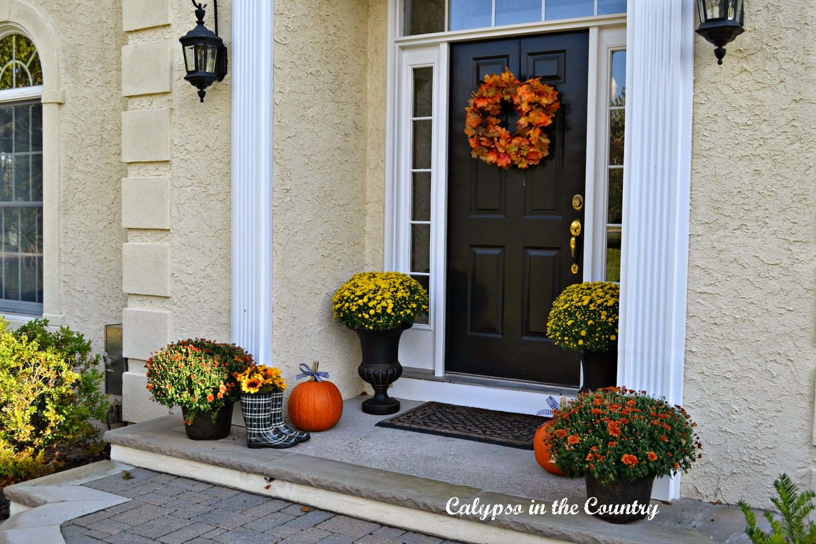 Fall Front Porch with Pumpkins and Rain Boots
