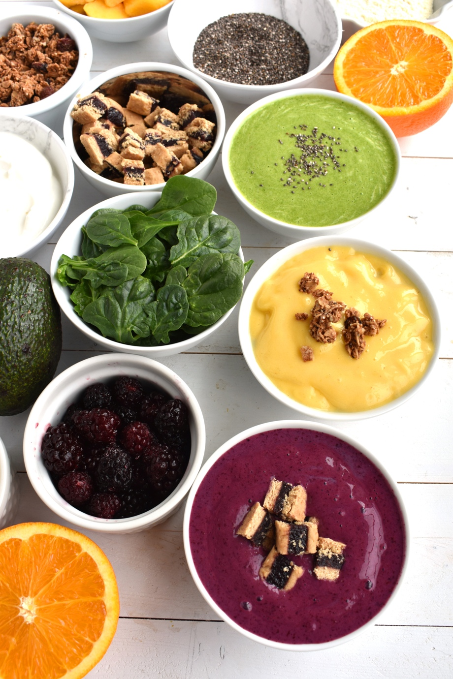 Build-Your Own Smoothie Bowl Bar has tons of smoothie ingredient options as well as fun toppings for the smoothie bowls! A fun party idea where everyone can customize their own smoothie bowl.