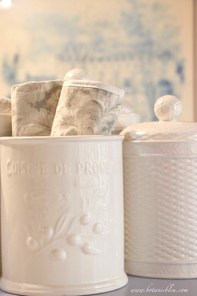 French Country Kitchen Summer to Fall White Canisters and Gray Linens