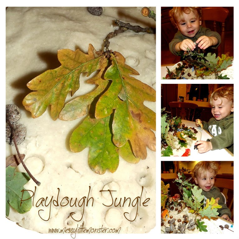 Playdough jungle with leaves, acorns, and twigs