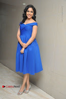 Actress Ritu Varma Pos in Blue Short Dress at Keshava Telugu Movie Audio Launch .COM 0019.jpg
